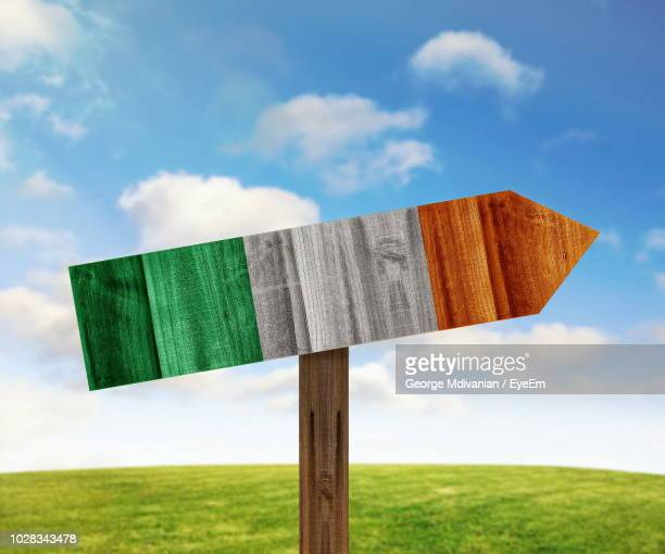 close-up of irish flag painted on wooden sign against sky - irish flag stock pictures, royalty-free photos & images