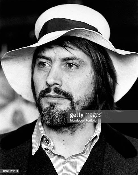 Closeup of Italian actor Giulio Brogi wearing a hat Rome 1971