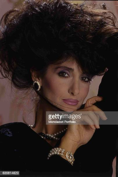 Close-up of Italian comedian Anna Marchesini for a studio photo shooting. Italy, 1986