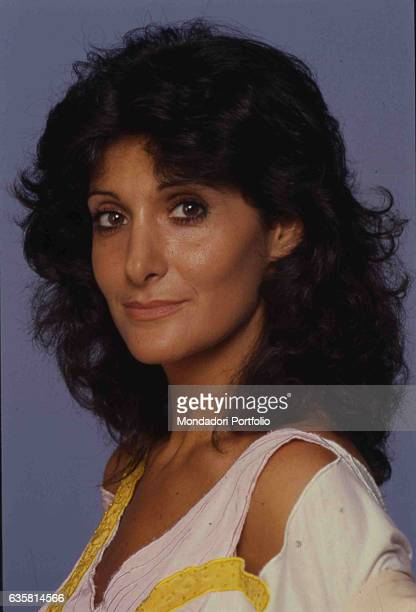 Close-up of Italian comedian Anna Marchesini posing for a studio photo shooting. Italy, 1985