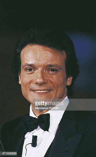 Closeup of Italian singer and theatre actor Massimo Ranieri in a black dinnerjacket presenting the Tv variety show 'Fantastico 10' Rome 1989