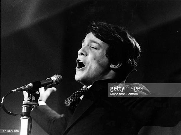 Closeup of Italian singer Massimo Ranieri singing at the 19th Sanremo Music Festival where he sings the song 'Quando l'amore diventa poesia' with...