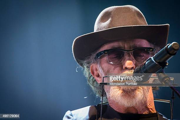 Closeup of Italian singersongwriter Francesco De Gregori playing the harmonica during his concert at Mediolanum Forum in Assago Milan 23rd March 2015