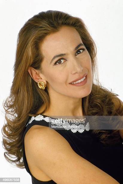 Closeup of Italian television host and actress Barbara D'Urso posing for a photo shoot inside a television studio Italy 1997