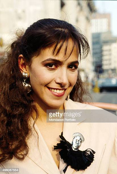 Closeup of Italian television host and actress Barbara D'Urso posing for a photo shoot on the set of the film 'Vogliamoci troppo bene' Italy 1989
