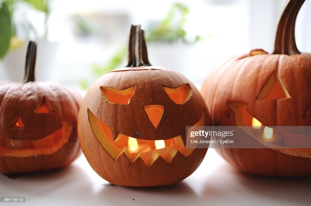 Close-Up Of Jack O Lanterns On Table During Halloween : Stock Photo