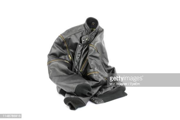 close-up of jacket against white background - giacca di pelle foto e immagini stock