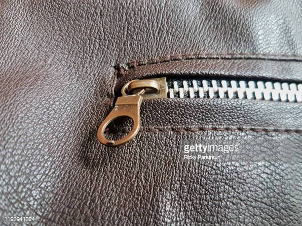 close-up of jacket chain - vintage stock stock pictures, royalty-free photos & images