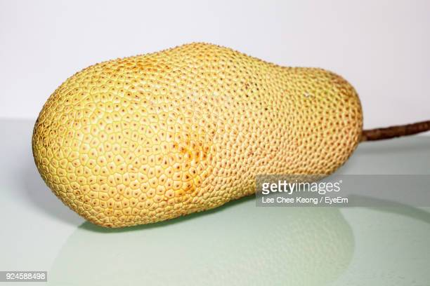 close-up of jackfruit on table against white background - jackfruit stock photos and pictures