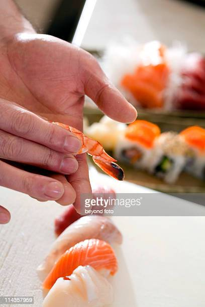 close-up of japanese chef making sushi