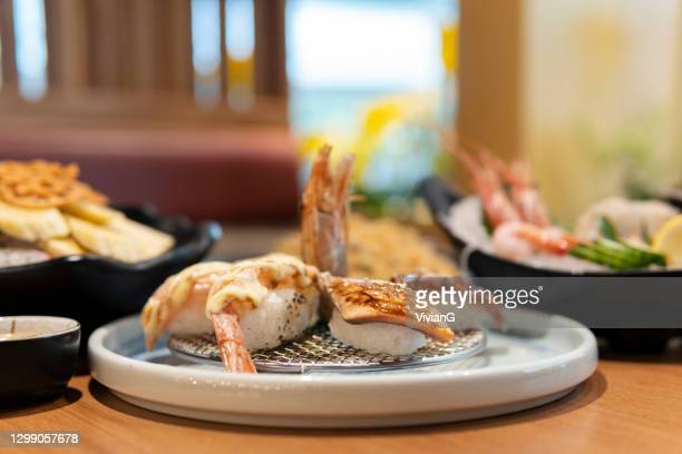 close-up of japanese sushi in the restaurant - embellishment stock pictures, royalty-free photos & images