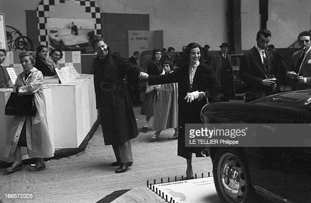 Close-Up Of Jean-Pierre Aumont And Marisa Pavan At The Motor Show. Paris, le 4 octobre 1956, le comédien Jean-Pierre AUMONT et son épouse Marisa...