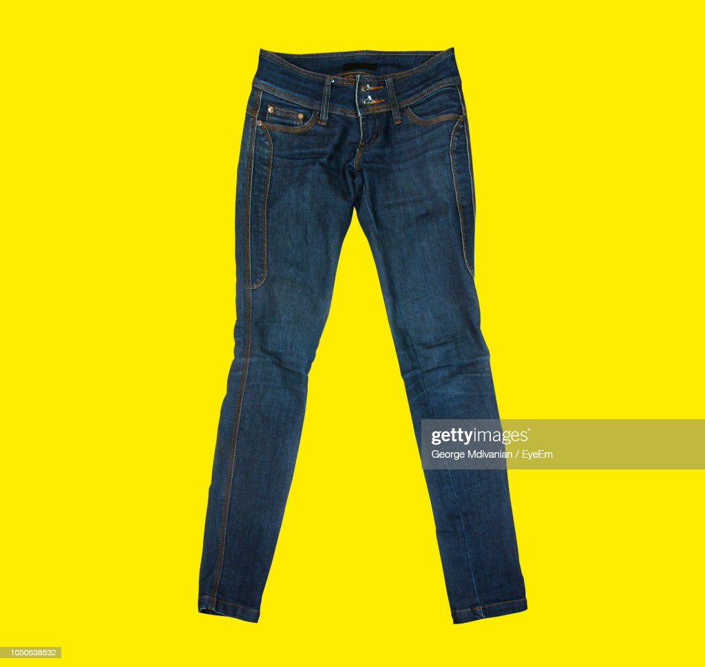 Close-Up Of Jeans Against Yellow Background : Stock Photo