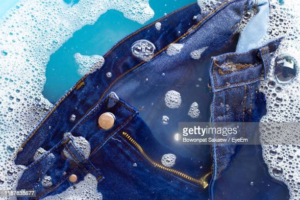 close-up of jeans in bucket - jeans stock pictures, royalty-free photos & images