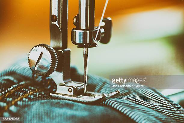 close-up of jeans in sewing machine - sewing machine stock pictures, royalty-free photos & images