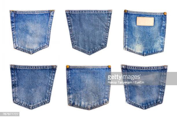 close-up of jeans pockets on white background - デニム ストックフォトと画像
