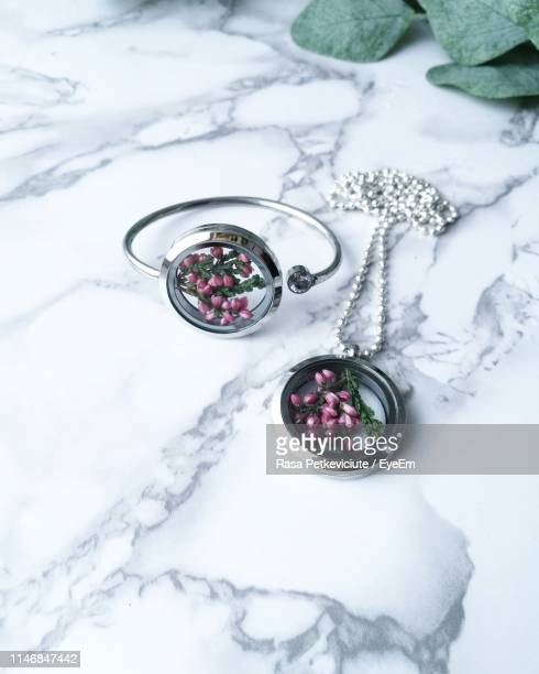 close-up of jewelries on table - ペンダント ストックフォトと画像