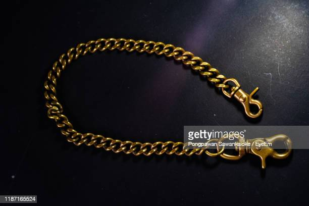 close-up of jewelry against black background - gold chain necklace stock pictures, royalty-free photos & images