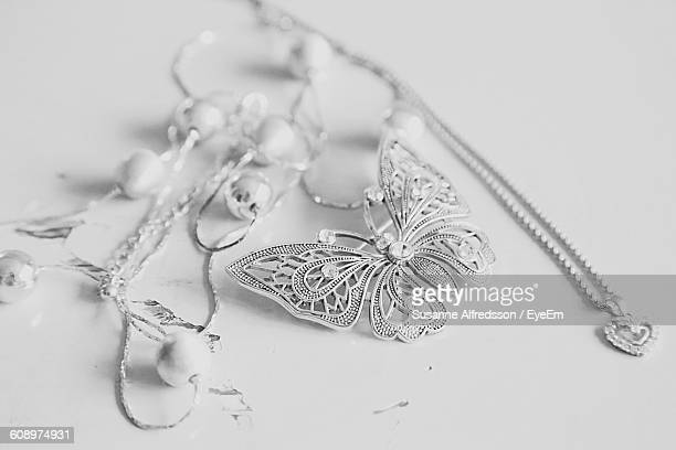Close-Up Of Jewelry Against White Background