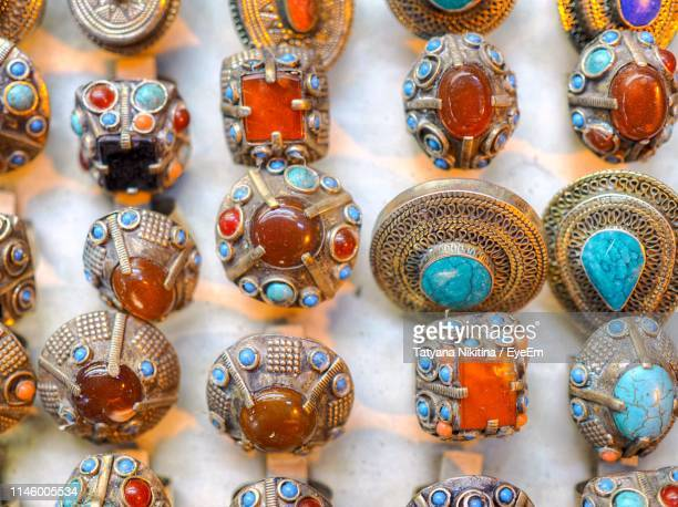 close-up of jewelry for sale at store - nikitina stock pictures, royalty-free photos & images