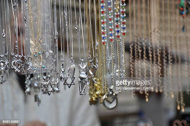 Close-Up Of Jewelry Hanging On Market Stall