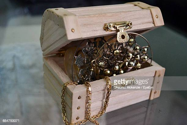 Close-Up Of Jewelry In Wooden Box