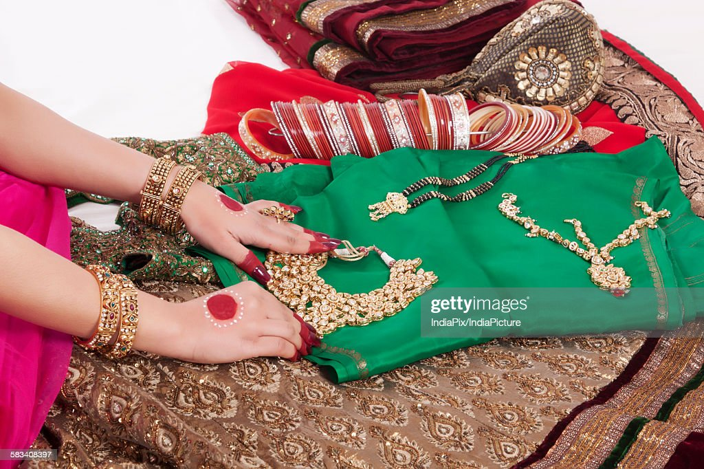 Close-up of jewelry , jewellery , bangles and wedding attire : Stock Photo