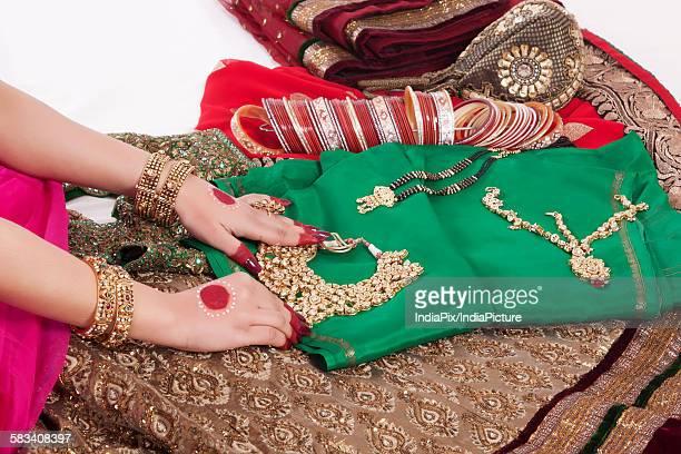 close-up of jewelry , jewellery , bangles and wedding attire - mangala sutra fotografías e imágenes de stock