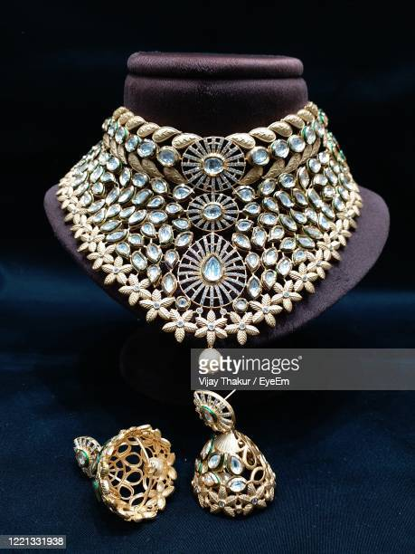 close-up of jewelry on table against black background - diamond necklace stock pictures, royalty-free photos & images