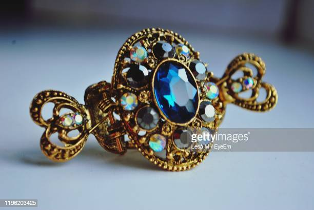 close-up of jewelry on table - antique stock pictures, royalty-free photos & images