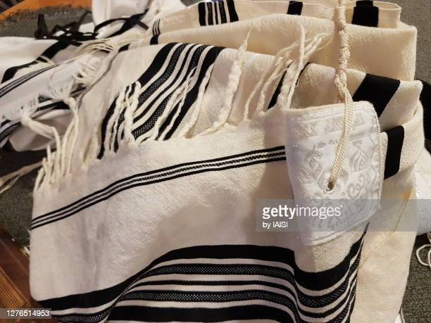 close-up of jewish prayer shawl / tallit, with black stripes according to the orthodox ashkenazic tradition - jewish prayer shawl stock pictures, royalty-free photos & images