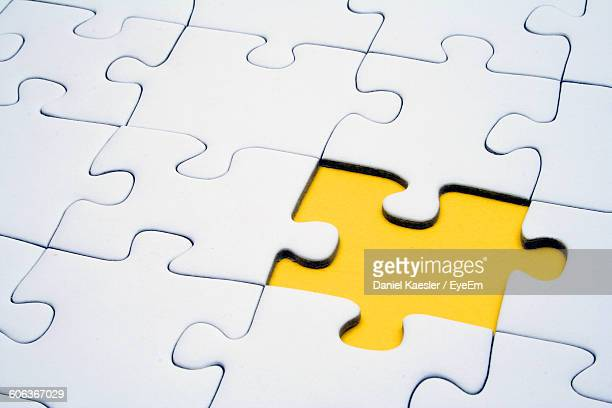 close-up of jigsaw puzzle - jigsaw piece stock pictures, royalty-free photos & images