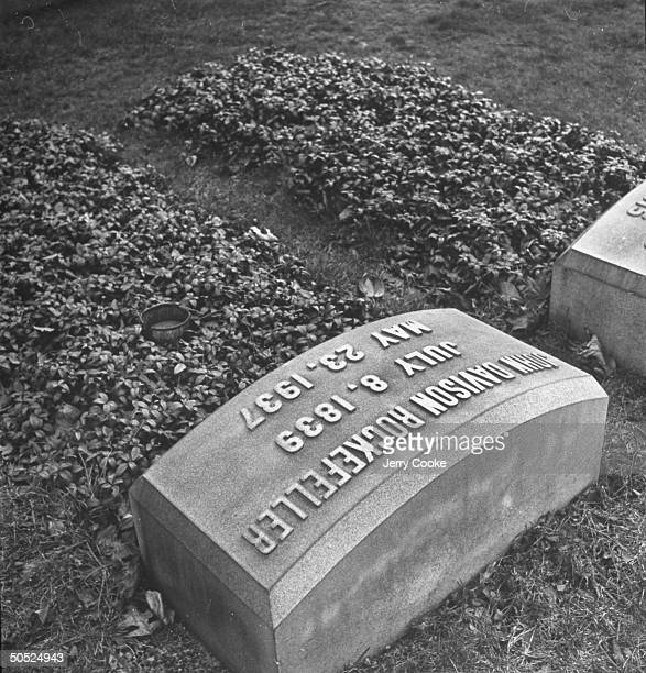 A closeup of John D Rockefeller Sr's head stone with his date of birth and death