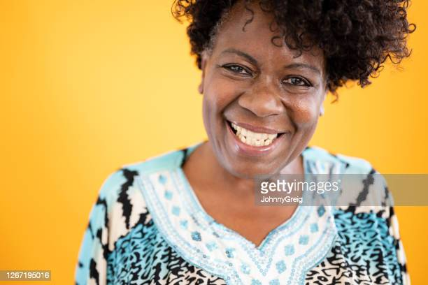 close-up of joyful senior black woman in casual dress - 60 64 years stock pictures, royalty-free photos & images