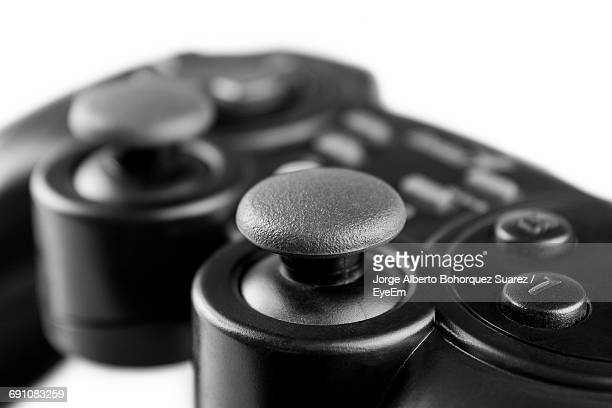 Close-Up Of Joystick On White Background