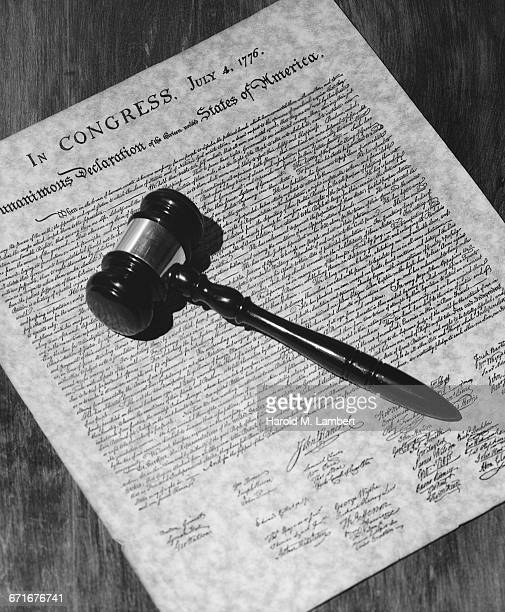 Close-Up Of Judge Gavel On Document