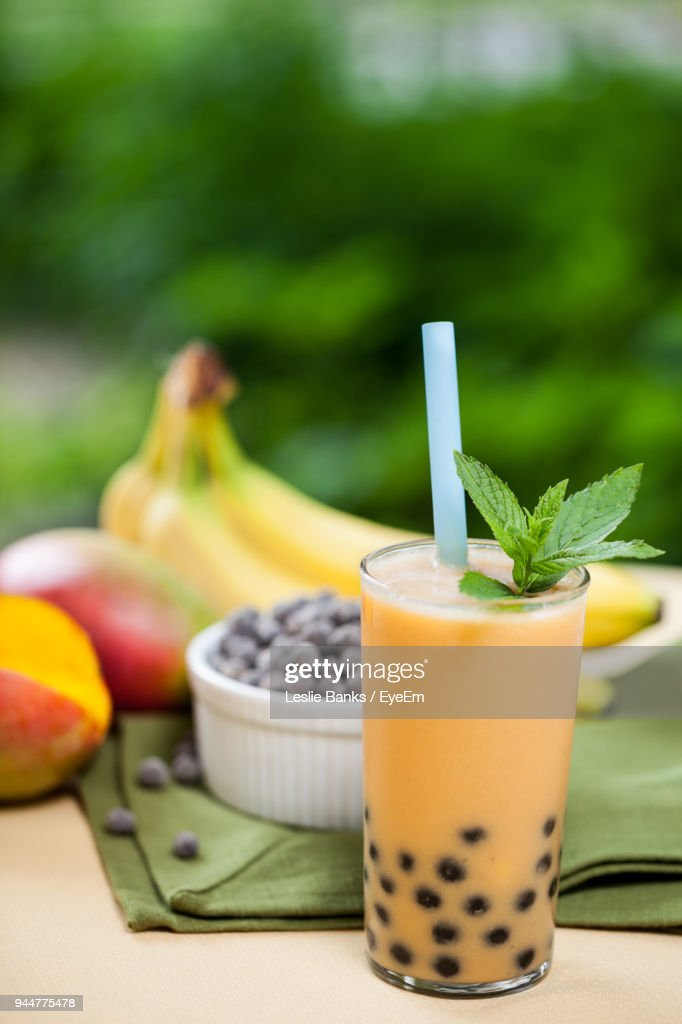 Close-Up Of Juice By Fruits On Table : Stock Photo