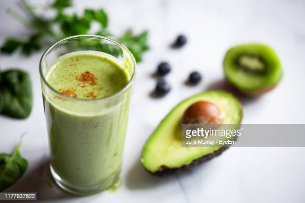 close-up of juice with avocado and kiwi on table - avocado stock pictures, royalty-free photos & images