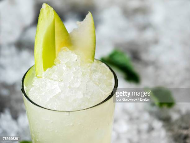 close-up of juice with crushed ice in glass - crushed ice stock pictures, royalty-free photos & images