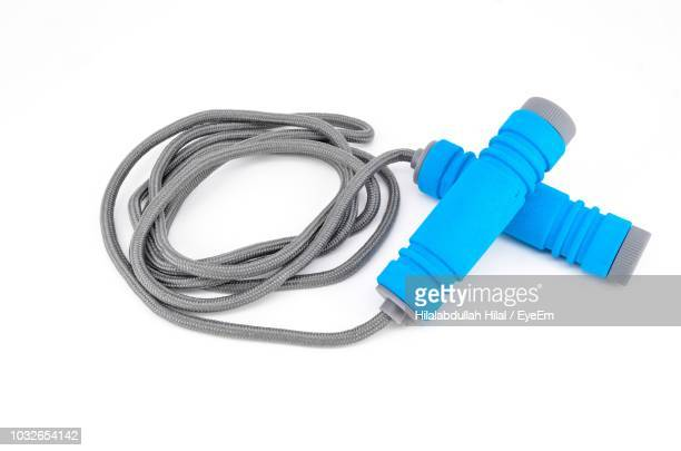 close-up of jump rope over white background - skipping rope stock pictures, royalty-free photos & images