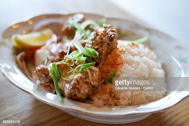 Close-Up Of Karaage Don Served With Rice On Table