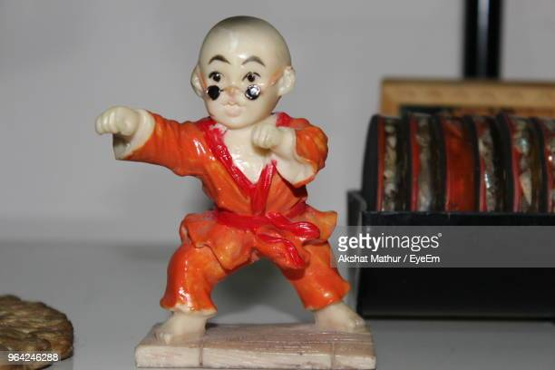 close-up of karate figurine on table at home - man cave stock pictures, royalty-free photos & images