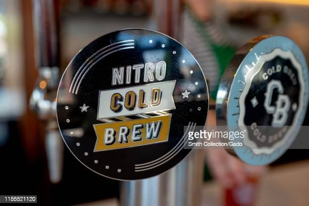 Closeup of kegstyle serving handle for Nitro Cold Brew Coffee a coffee drink using compressed nitrogen to dispense cold brew coffee June 10 2019