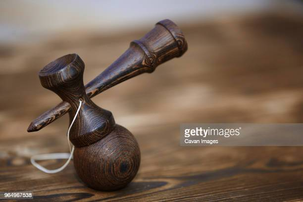 Close-up of kendama on table