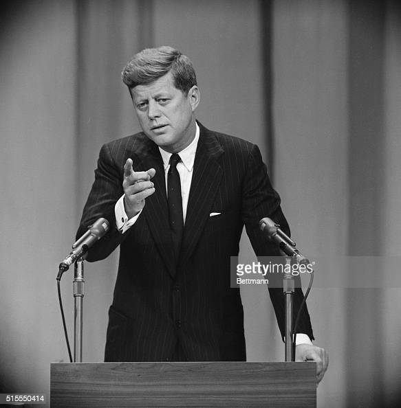 President Kennedy gestures today during the beginning of ...