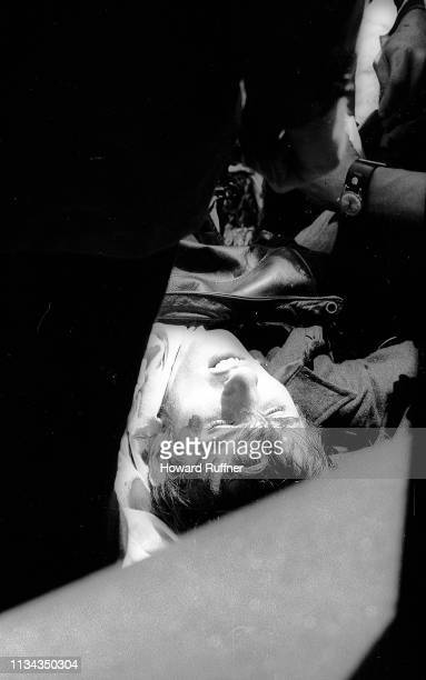 Closeup of Kent State University student John Cleary as he lies on the ground after having been shot when the Ohio National Guard opened fire on...