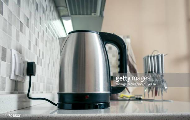close-up of kettle on kitchen counter - やかん ストックフォトと画像