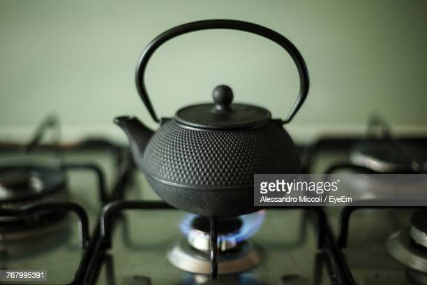 close-up of kettle on stove - alessandro miccoli stockfoto's en -beelden