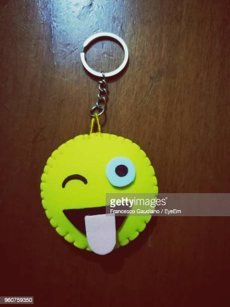 Close-Up Of Key Chain Hanging On Wooden Door