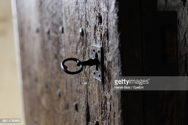 Close-Up Of Key In Lock On Door